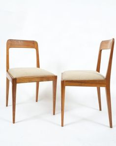 Carl Aubock. Rare set of six wooden chairs designed and executed by Carl Auböck and Robert Nestler in the 1950s (Model No. A 7) made from wood with an upholstery made of beige fabric. The condition is very good (one chair shows signs of it gotten glued) Upholstery might be customized. Seat height is 18.5 in. (47 cm).