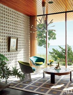 The light fixture is by Rewire Gallery, the Warren Platner lounge chairs by Knoll are vintage, and the low table and rug are by Adler. http://www.architecturaldigest.com/gallery/jonathan-adler-simon-doonan-shelter-island-home-slideshow?crlt.pid=camp.2QHTMNmItLQ5