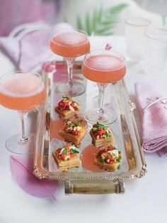This delicious cocktail recipe is made with homemade rhubarb syrup, orange juice, gin and chilled sparkling wine.