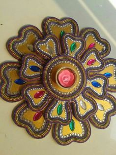Three layered wooden rangoli