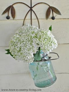 Tuck white hydrangeas in a blue jar for instant summer charm