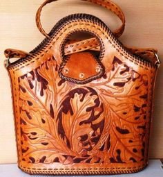 Oak leaf motif tooled leather bag. Hand tooled leather bag that can be customized with a design of your choice