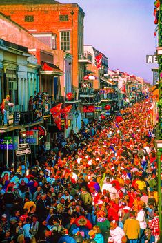 Huge crowd packs Bourbon Street on Fat Tuesday, Mardi Gras, New Orleans, Louisiana USA
