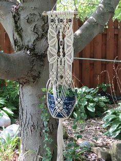 Macrame plant hanger on driftwood with brown beads, cotton rope, lace pattern, $48.00  https://www.etsy.com/listing/245670300/macrame-plant-hanger-on-driftwood-with?ref=shop_home_active_1