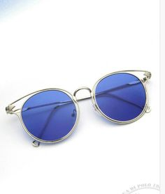 blue sunglasses ...Trendy and aesthetically pleasing Reduces glare Helps define contours Enhances color perception