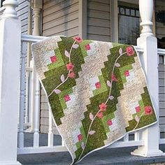 Pink Vine Fantasy - You won't believe how easy it is to create this gorgeous springtime quilt. This easy-to-make quilt was inspired by the log cabin block and appliqué flowers from Eleanor Burns.