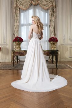 Justin Alexander 8757  Silk chiffon, venice lace, beaded lace A-line dress highlighted with a strapless neckline. Create a fuller skirt with a fuller petticoat