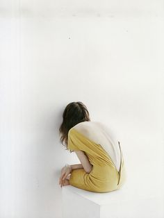 When she is imprisoned, her clothes askew, her head against the wall, either in thought or despair.