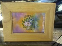 """cross stitch """"Conserve Preserve & Enjoy"""" The 5x7 light wood frame can be hung or stand nicely on a bureau or desk. Tie Dyed Pastels surround this special scene!"""