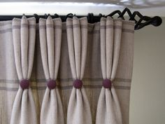 Dress curtains with buttoned pleats