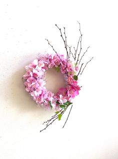 桜とかすみ草のリース 横約25㎝ 縦約40㎝