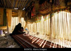 A Bedouin woman weaving in her tent, Oman. © Imagestate Media Partners Limited - Impact Photos / Alamy