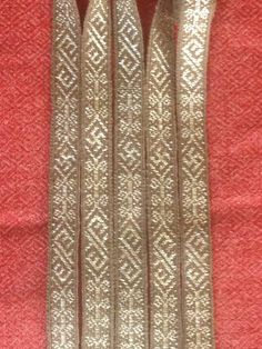 INSPIRED BY Birka, 1,3 cm width, 200 cm long tablet woven by Stephan Franke  B > this is a brocade technique; this is NOT a reproduction of entirely Birka-Source motifs, I don't know where the circle-on-rod motif comes from.