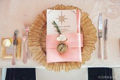 This table setting hits all the right notes with a seafan-inspired plate and compass details. See more from this Nantucket Wedding at dailycatch.coastalliving.com and @soireefloral