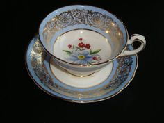 Paragon By Appointment to Her Majesty The Queen Blue, Gold and Floral Tea Cup and Saucer