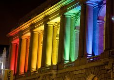 San Francisco Opera House at night, with rainbow colored lights to celebrate gay pride, the weekend of the parade.