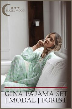 The Gina Pajama Set in Forest features a subtle and chic all-over tree print. The pale blue and green trees give this pajama set a unique look and feel. The modal clothing drapes in a way that is flattering on all body types and allows you to move with ease. Gina was made for year-round sleep and will keep you just as cozy in the summer as it will when the temperature drops. Order this classic women's pajama set today. #HazelMoon #LuxuryLoungewear