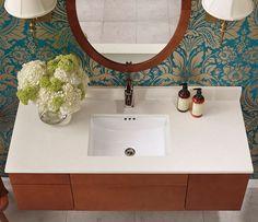 Ronbow vanity, love the oval mirror and wallpaper! #vanity #glambath #woodvanity #sconces #undermount sink #stonetop #ronbow #bathroom #trendybath