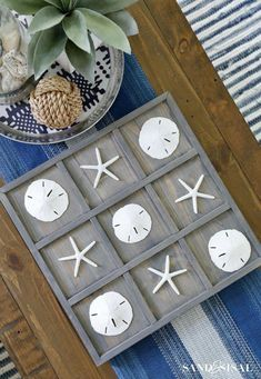 Add a bit of the beach to your home with a DIY Coastal Tic-Tac-Toe board, complete with starfish and sand dollars for X's and O's. Such a cute and easy summer project! #coastalstyle Seashell Crafts, Beach Crafts, Sand Crafts, Seashell Decorations, Seashell Art, Coastal Style, Coastal Decor, Coastal Entryway, Coastal Lighting