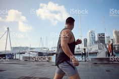 Pacific Islander Man Running in Urban Cityscape Scene royalty-free stock photo Kiwiana, Scene Photo, Sport Casual, The Locals, New York Skyline, Royalty Free Stock Photos, Urban, Running, Lifestyle