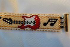Red Guitar Music Note Peyote Stitch Seed Bead Bracelet. $25.00, via Etsy.