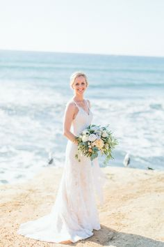 Blush & ivory Sunset Cliffs beach wedding by San Diego wedding florist, Compass Floral.