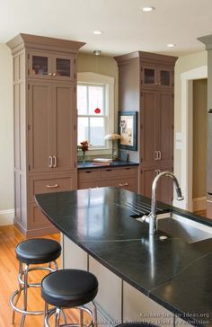 Idea of the Day: Gray kitchen cabinets in traditional homes. (By Crown Point Cabinetry) Grey Kitchen Cabinets, Kitchen Redo, New Kitchen, Kitchen Remodel, Kitchen Design, Kitchen Ideas, Crown Point Cabinetry, Soapstone Countertops, Island With Seating