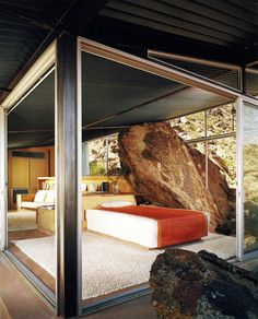 Frey house II, Palm Springs CA 1965. The bottom shot shows the famous bolder intersecting the bedroom.