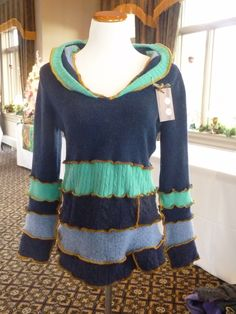 hooded upcycled sweater  $137.00  www.kreationality.com