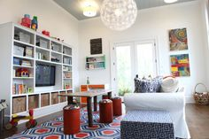 We wanted to give the playroom in the mountain house a fun fresh vibe. Lots of color (but not too much), and lots of organization so when t...