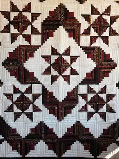 This lovely hand quilted queen size quilt measures 103″ x 113″ and features burgundy and black with white and cream.