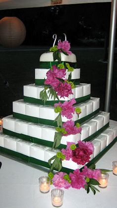Wedding cake I made using individual cupcakes in boxes topped with a fondant covered square cake for cutting.