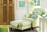 Great light green chair  and ottaman with blue accents