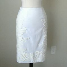 Embroidered applique pencil skirt Fully lined,  58% cotton, 38% rayon, 4% spandex, invisible center back zip, slit at center back, waist 32.5 inches, hip 42 inches, length 23 inches White House Black Market Skirts Pencil