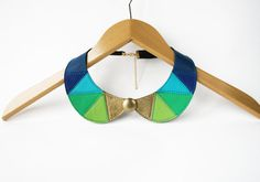 Hey, I found this really awesome Etsy listing at https://www.etsy.com/listing/210635030/blue-green-gold-leather-bib-necklace