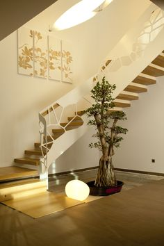 gorgeous staircase and I love the idea of putting a tree right there