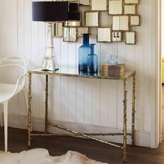 Elegant cast aluminium twig console table with a blackened gold finish and a glass table top.