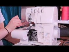 How to Thread a Serger - Overlock Machine - YouTube.  Conveniently this is my exact machine :D
