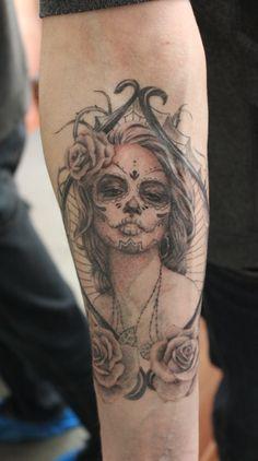 Santa Muerte . Black and gray tattoo .