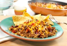 Just one skillet is all you need to make this zesty beef dish made with tomatoes, kidney beans and instant rice. It's topped with Cheddar cheese and served with tortilla chips...now doesn't that sound good?