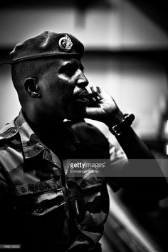 Photographic Essay on life in the French Foreign Legion in Djibouti; the image shows a close-up portrait legionnaire with his beret.
