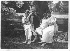 W.A., Anna, Andrée (with her mother), and Huguette Clark (with her father), c. 1912.