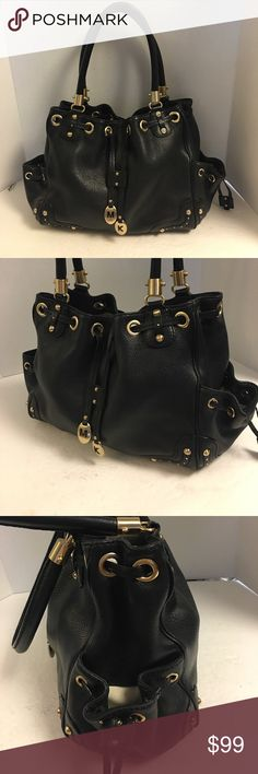 Michael Kors studded leather drawstring satchel This is a beautiful gently used Michael Kors black pebbled leather gold studded satchel with beautiful antique gold hardware. Drawstring closure. Two side pockets with drawstring closure. Double handles. Magnetic strap closure. Has zipper pocket and four slip pockets inside. A little discoloration or the bottom of lining. Otherwise fantastic. MICHAEL Michael Kors Bags Satchels