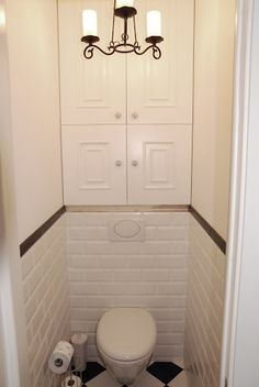 Love the built in cabinet above toilet.  Great idea!