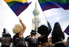 Revellers wave rainbow flags in front of the national monument of the Divine Savior of El Salvador during a gay pride parade in San Salvador. Hundreds of LGBT rights activists participated in the annual parade. (Photo: Ulises Rodriguez/ Reuters) http://www.theatlanticcities.com/arts-and-lifestyle/2012/07/gay-pride-parades-around-world/2485/