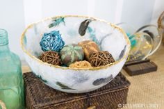 Prep a plastic bowl with nonstick coating, and brush on a thin layer of resin. When the resin is tacky, add embellishments like feathers and gold leaf. Cover with white tissue paper, repeat as desired, and let harden—our piece is ten layers thick.