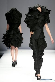 Origami Fashion - dramatic sculptural garments with complex 3D folded structures; wearable art