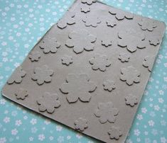 Make your own embossing plates.  The technique to make the Folder:    1) Cut an image out of cardboard (cereal box thickness)  2) Stick the pieces on more cardboard  3) Seal it all up with some Mod Podge