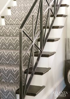 A graphic runner by Stark Carpets complements a custom iron stair rail. A graphic runner by Stark Carpets complements a custom iron stair rail. Wrought Iron Stair Railing, Metal Stairs, Staircase Railings, Wooden Stairs, Staircase Design, Stairways, Banisters, Staircase Runner, Spiral Staircases