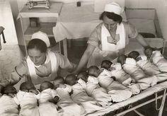 Vintage nurses caring for the 11 babies born on New Year's Eve. –Germany, 1933 -- 65 Photos of Vintage Nurses—Nurses Through the Centuries #nursebuff #nurse #vintage
